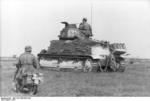 German soldiers on PzKpfw 35 S 739(f) medium tank and motorcycle, France, 1941