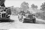 German vehicles in a town in the Soviet Union, Jun 1941; note Soviet BA-10 armored car on the side of the road