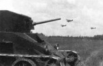 BT-2 tank with 35mm gun at rest, circa 1930s; note Polikarpov R-5 reconnaissance aircraft in background