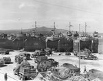 US Army CCKW 2 1/2-ton 6x6 cargo trucks bringing supplies to US Navy LSTs, Naples, Italy in preparation for the invasion of southern France, Aug 1944