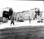 US Army CCKW 2 1/2-ton 6x6 cargo trucks unloading supplies from US Navy LSTs in Marseille, France, Sep 1944