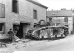 A Belgian civilian and a German soldier looking at an abandoned French Char B1 heavy tank, Ermeton-sur-Biert, Belgium, mid-May 1940