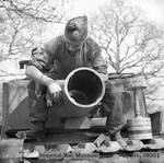 Soldier maintaining the 29cm Petard spigot mortar on a Churchill AVRE of 79th Squad, 5th Assault Regt, Royal Engineers, UK 3rd Infantry Division, 29 Apr 1944; note 40-lb bomb on right