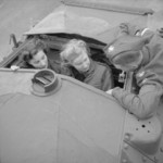 A sergeant from the British Fife and Forfar Yeomanry showing two female factory workers the turret of a Covenanter tank, Wellingborough, Northamptonshire, England, United Kingdom, 26 Oct 1941
