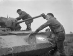 British 1st Armoured Division tankers climbing aboard their Covenanter tank, Britain, 20 Dec 1941