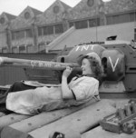 Female worker at the B. T. H. factory in Neasden Lane, Willesden in London, England, United Kingdom writing messages on a Covenanter tank of British Guards Armoured Division, 22 Sep 1942