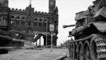 A Cromwell tank guarding a bridge over the Elbe River, Hamburg, Germany, 3 May 1945