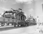 British Cruiser Mk IV tanks being loaded onto railway trucks at an Egyptian quayside after being unloaded from ships, 5 Oct 1940