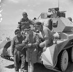 The crew of a British Cruiser Mk IV tank studying a map in the Western Desert, Egypt, 30 Apr 1941