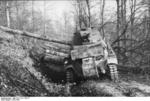 German Panzerkampfwagen 39H 735(f) tank being used to remove trees in a Balkan forest, 1941-1942 photo 1 of 2