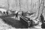 German Panzerkampfwagen 39H 735(f) tank being used to remove trees in a Balkan forest, 1941-1942 photo 2 of 2