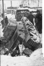 German troops recovering a Panzerkampfwagen 39H 735(f) tank that had fallen into a stream, Yugoslavia, 1941-1942, photo 1 of 2