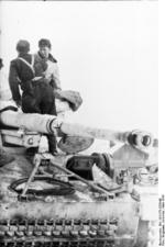 Two German soldiers on a Hornisse/Nashorn tank destroyer, Russia, Mar 1944