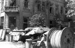 Polish barricade at Napoleon Square, Warsaw, Poland, 3 Aug 1944, photo 1 of 4; note captured Jagdpanzer 38(t) tank destroyer as part of barricade