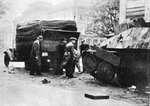 Destroyed Jagdpanzer 38(t) on the street of Warsaw, Poland, 5 Aug 1944; this vehicle was captured by Polish fighters and destroyed by Germans during fighting near the main post office