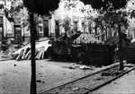 Polish barricade at Napoleon Square, Warsaw, Poland, 3 Aug 1944, photo 3 of 4; note captured Jagdpanzer 38(t) tank destroyer as part of barricade