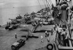 Jeep vehicles and SBD Dauntless aircraft aboard an aircraft carrier in the Solomon Islands area, 5 Nov 1943