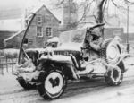 A jeep of US Army 30th Infantry Division in Belgium, 27 Jan 1945; note Browning M1919 machine gun, radio antenna, anti-decapitation bar, and unusual spare tire location