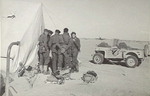 Pilots of No. 3 Squadron RAAF discussing operational plans outside their tents in Libya