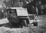 General Douglas MacArthur in a Ford GPW Jeep at US 43rd Division Command Post area, Philippine Islands, 1944