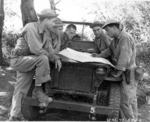 US personnel in the Pacific checking their map on a Willys MB slat-grille Jeep, 15 Mar 1943