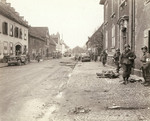 US soldiers in a recently captured town, 9 Dec 1944; note fallen US soldier