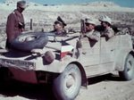 Kübelwagen vehicles of the German Afrikakorps operating in desert conditions, 1940-1943, photo 2 of 3; note the oversize tires that offered better performance on soft surfaces like sand