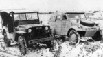 Willys MB Slat-Grille Jeep parked beside a Type 82 Kübelwagen, probably on the Eastern Front, date unknown