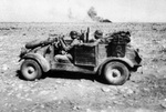 Kübelwagen vehicles of the German Afrikakorps operating in desert conditions, 1940-1943, photo 3 of 3; note the oversize tires that offered better performance on soft surfaces like sand