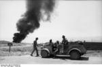 German troops with a Type 82 Kübelwagen with the fires of Tobruk, Libya in the background, Aug-Sep 1942