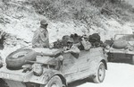 Kübelwagen vehicles of the German Afrikakorps operating in desert conditions, 1940-1943, photo 1 of 3; note the oversize tires that offered better performance on soft surfaces like sand