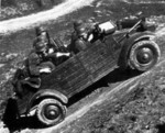 Kübelwagen loaded with troops showing its versatility on uneven terrain during testing, circa 1940