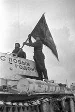 Soviet tank crew raising a flag on a KV-1 heavy tank, Moscow, Russia, 31 Dec 1941