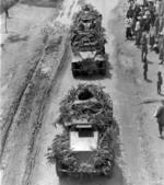 Troops of the Chinese 200th Division in a SdKfz. 221 armored car column, date unknown