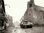 M10 tank destroying in a heavily damaged town, Europe, 1944-1945