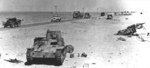Italian M11/39 tank and other vehicles in North Africa, date unknown
