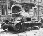 Disabled Italian-made PzKpfw 736(i) tank in Warsaw, Poland, 22 Aug 1944