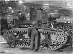 British workers working on a M2A4 light tank that had just arrived from the United States, circa 1941