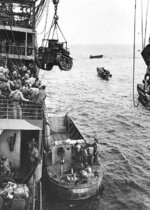 M2A4 Stuart tank being hoisted from USS Alchiba into a LCM(2) landing craft, off Guadalcanal, Solomon Islands, 7 Aug 1942