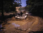 US Army M2 light tank traveling through mud obstacle, Fort Knox, Kentucky, United States, Jun 1942