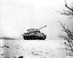 M36 Jackson tank destroyer, camouflaged in white, operating near Dudelange, Luxembourg, 3 Jan 1945