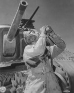 Corporal Philip Margherito of HQ Company, US 752nd Tank Battalion drinking water during a M3 medium tank training mission, Desert Training Center, Indio, California, United States, 10 Jun 1942