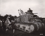 Sgt. Hiram Prouty of US 175th Infantry Regiment dressed as Santa Claus during the Christmas season, arriving on a M3 medium tank, Perham Down, England, United Kingdom, 5 Dec 1942