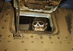 M3 medium tank driver looking through the forward port hole, Fort Knox, Kentucky, United States, Jun 1942