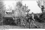 German soldiers camouflaging a Marder I tank destroyer, southern France, 1942
