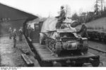 Unloading a Marder I tank destroyer from a train car, Belgium or France, 1943-1944, photo 01 of 10