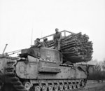 Churchill AVRE vehicle with fascine, of UK 79th (Experimental) Armored Division Royal Engineers, Italy, 19 Dec 1944