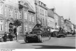 German Panzer II and Panzer I light tanks in a town in Denmark, Apr 1940