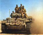 PzKpfw III medium tank in North Africa, circa 1940-1942; note spare wheels and treads mounted in front of the hull