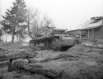 Wrecked Panzer III tank and killed German tanker at Skirmanovo near Moscow, Russia, circa 1942